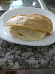 keto bread made from fried pieces of tofu with a fried egg
