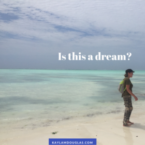 """Person with narcolepsy on idyllic beach with text """"Is this a dream?"""""""