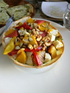 Salad with tomatoes, pumpkin, nuts etc.
