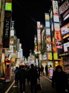 a Tokyo street lit up by hundreds of signs
