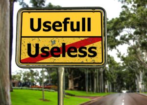 "Road sign with word ""useless"" crossed out and useful on top"