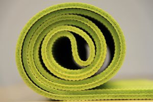 rolled up green yoga mat