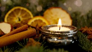 candle, cinnamon, and orange slices