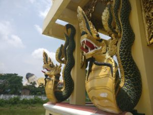 two burmese python dragon creatures carved into a structure