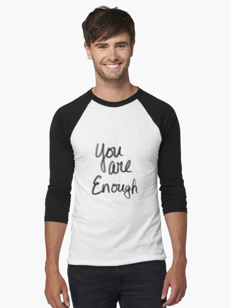 "A cute guy wearing a long sleeve shirt that says, ""You are Enough"""