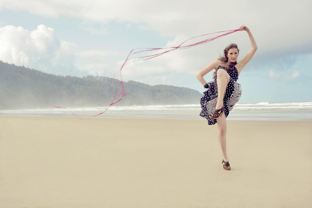 Woman with lots of energy on a beach
