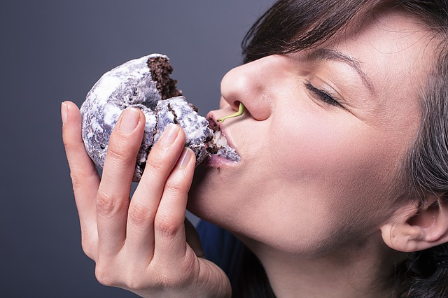 Woman indulging in chocolate pastry